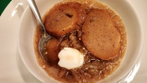 French Onion Soup with a dollop of sour cream and homemade croutons.