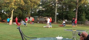 Family and friends enjoy games during cookout