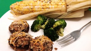 Stuffed mushrooms pair well with steamed broccoli and corn on the cob